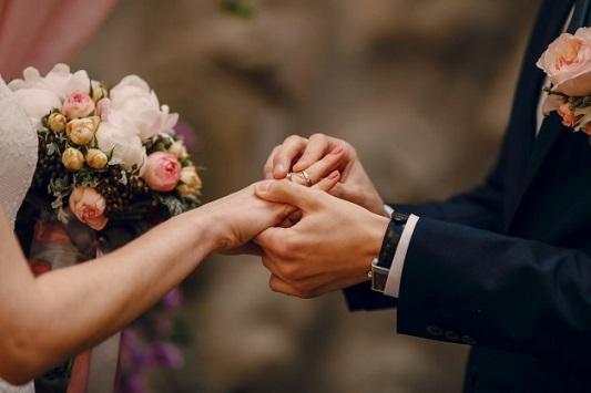 groom-putting-ring-on-bride-s-finger 1157-338
